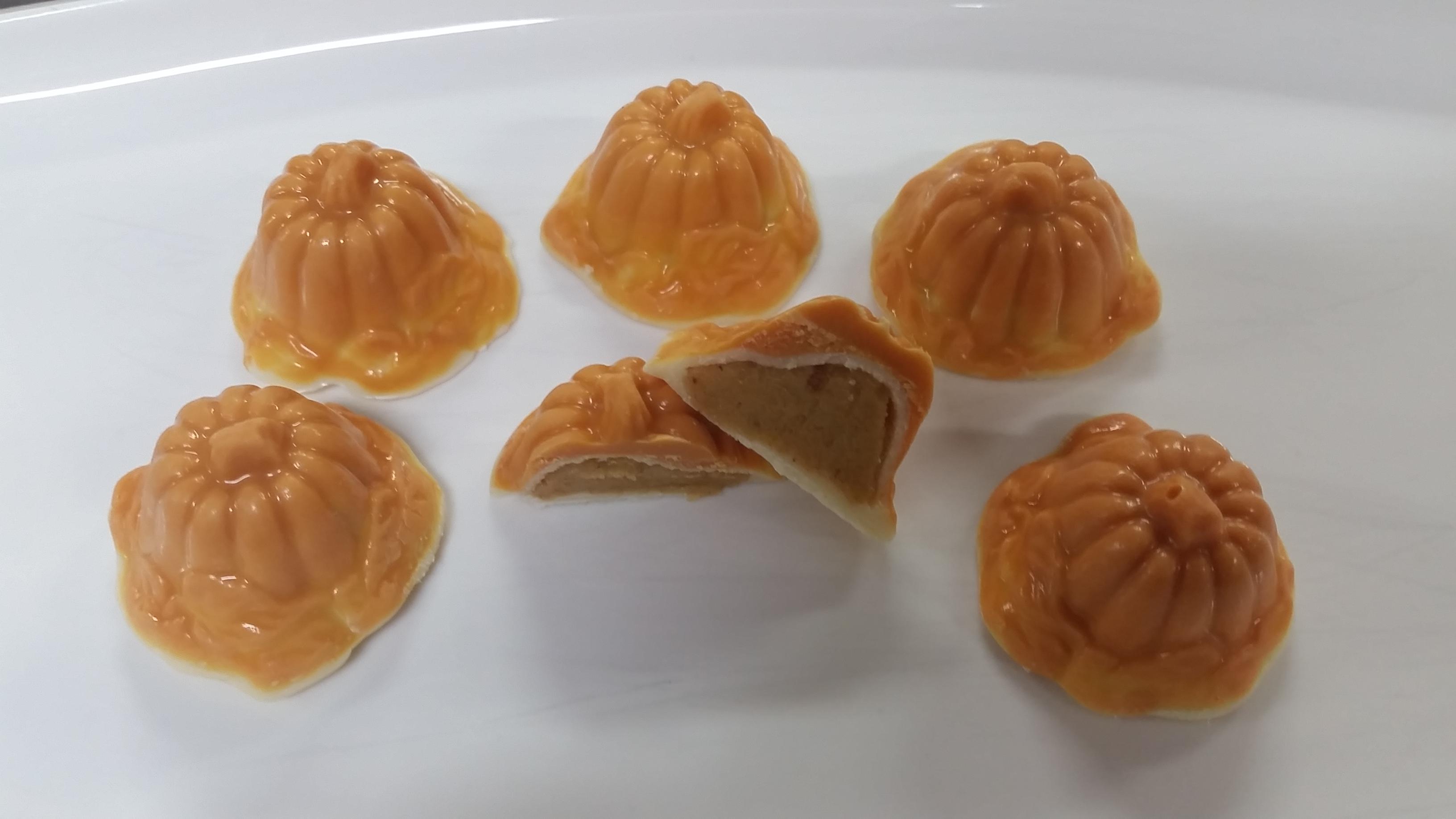Pumpkin Truffles. White and orange chocolate with a pumpkin ganache center.