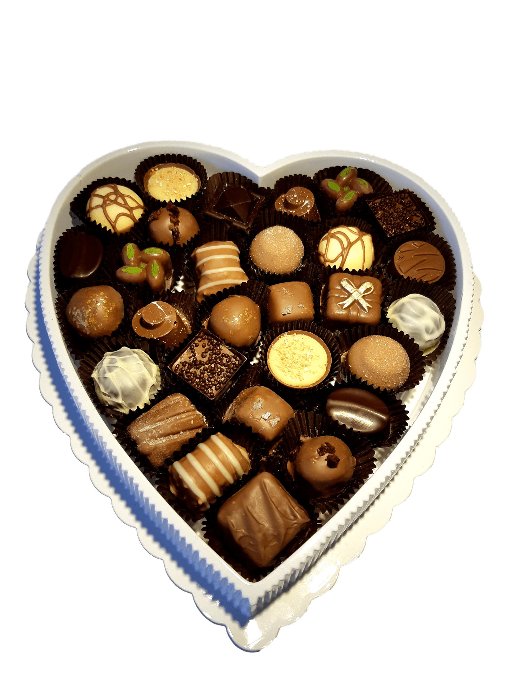 Picture of heart shaped box with assorted truffles made in store.