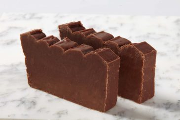 Product Shot. Two slices of Milk Chocolate Fudge on a marble slab